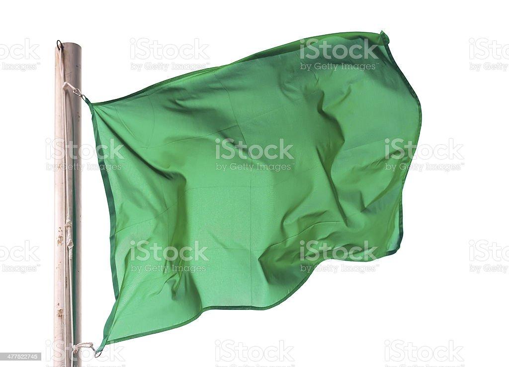 waving green flag over white stock photo