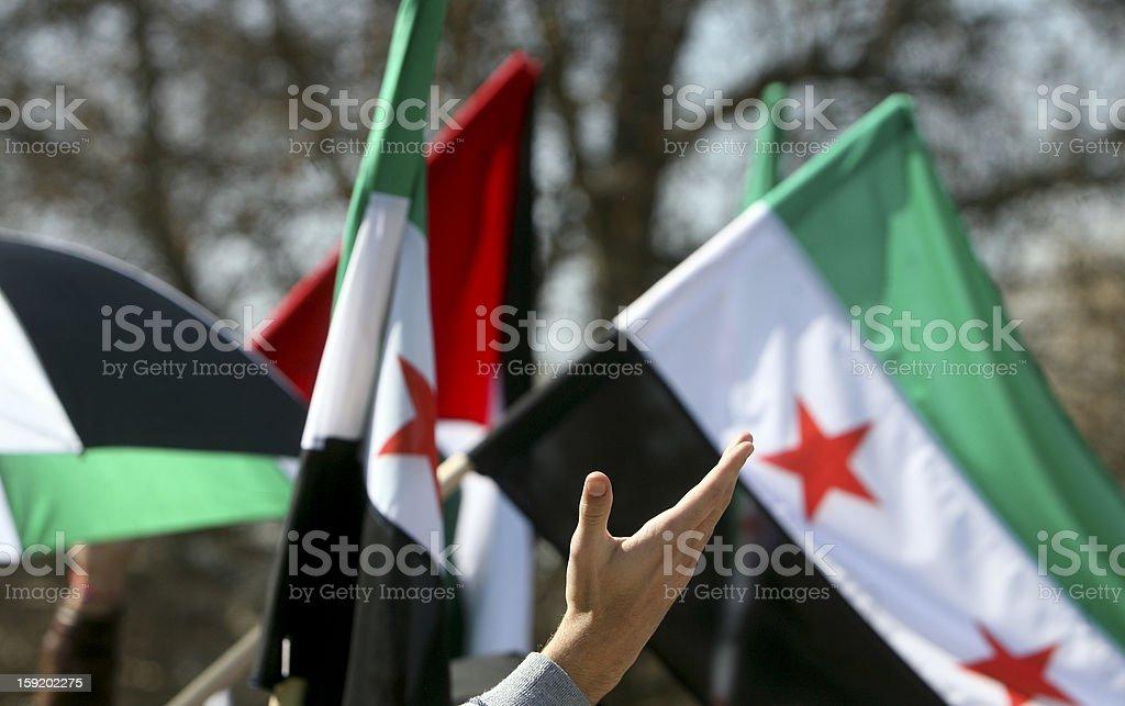 Waving hand Syrian flags stock photo