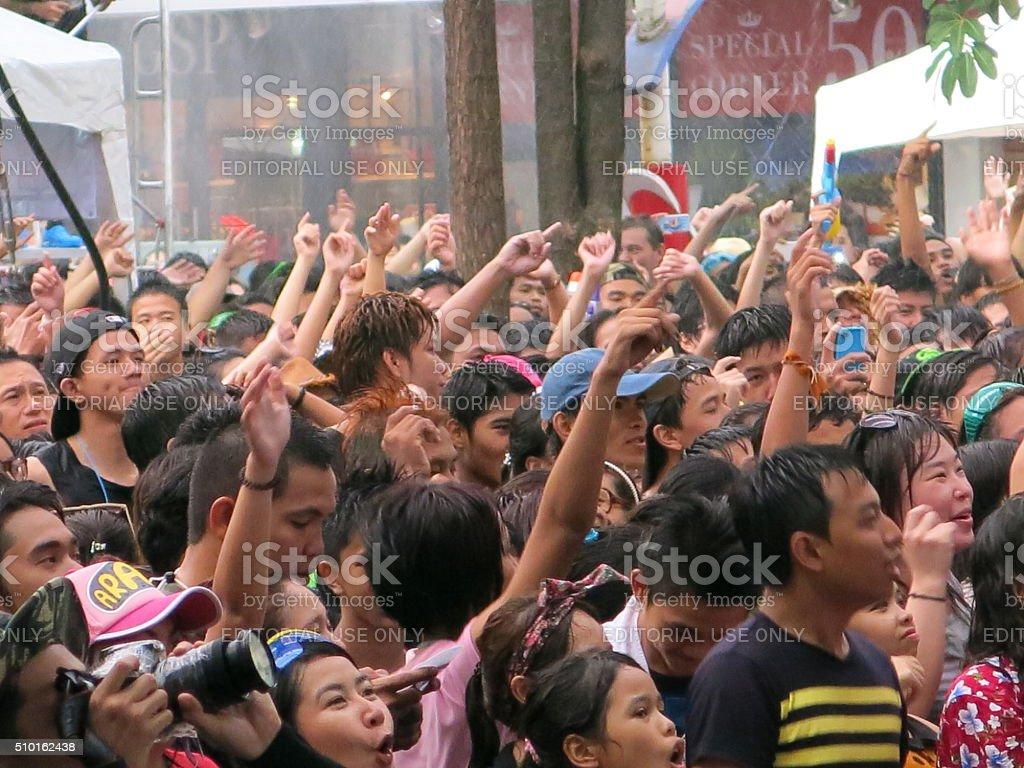 Waving hands in concert stock photo