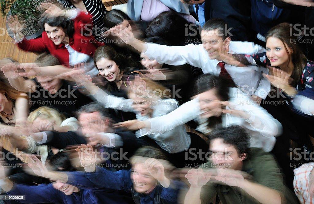 Waving happy crowd stock photo