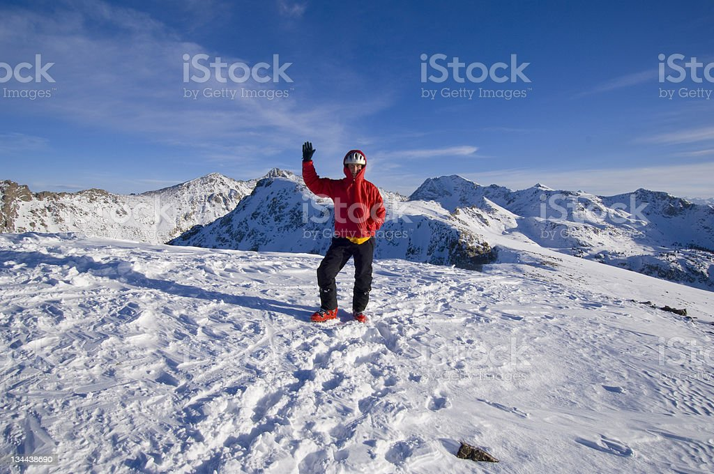 Waving Hello on top of a High Mountain royalty-free stock photo