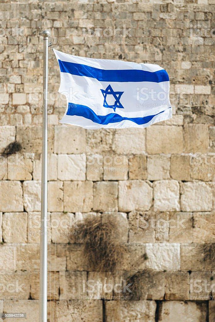 Waving Israeli flag near Wailing Wall, Old City, Jerusalem stock photo