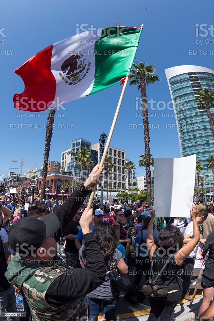 Waving Mexican flag at anti-Trump protest stock photo