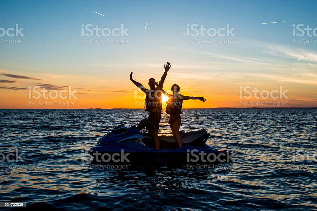 Waving On A Jet Boat At Sunset stock photo