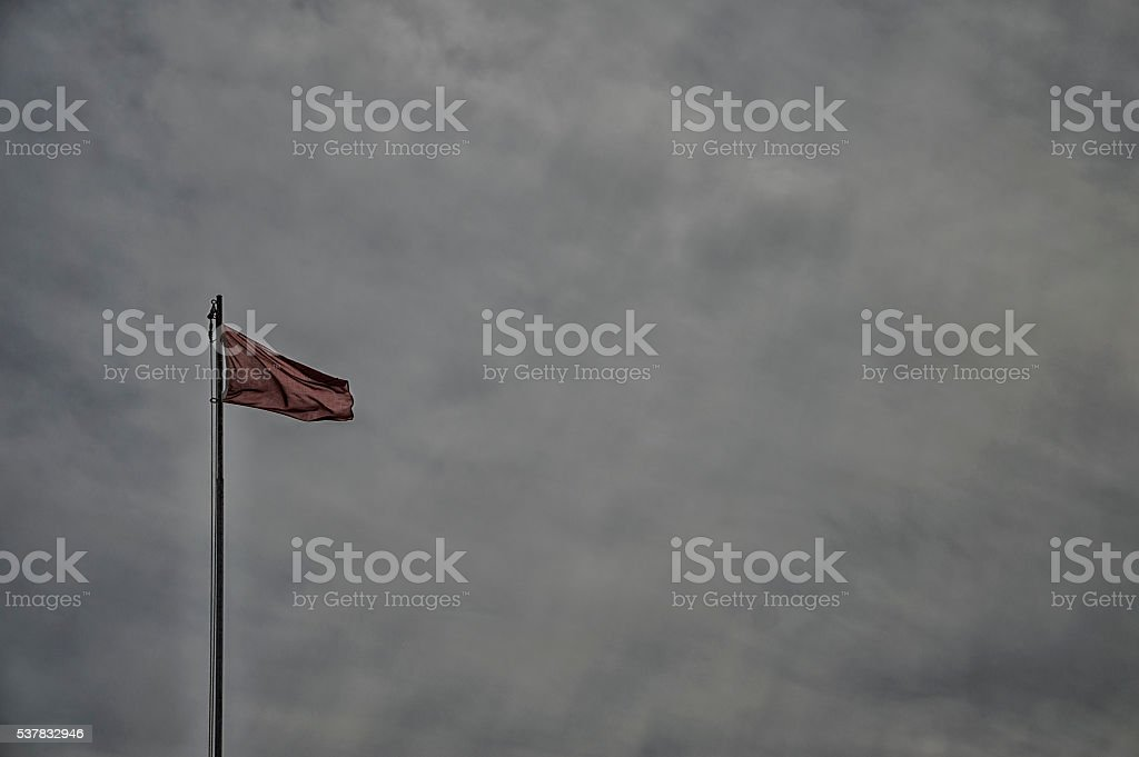 Waving red flag stock photo