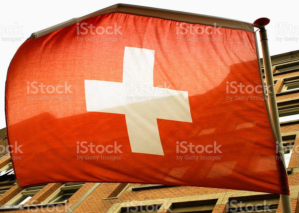Waving Swiss flag on the wind stock photo
