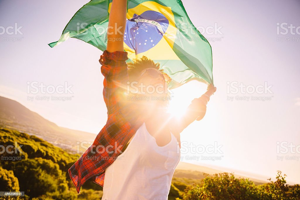 Waving the brazilian flag stock photo