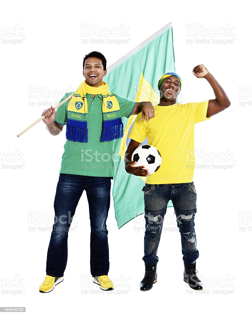 Waving the flag for Brazil: two happy soccer fans cheer stock photo