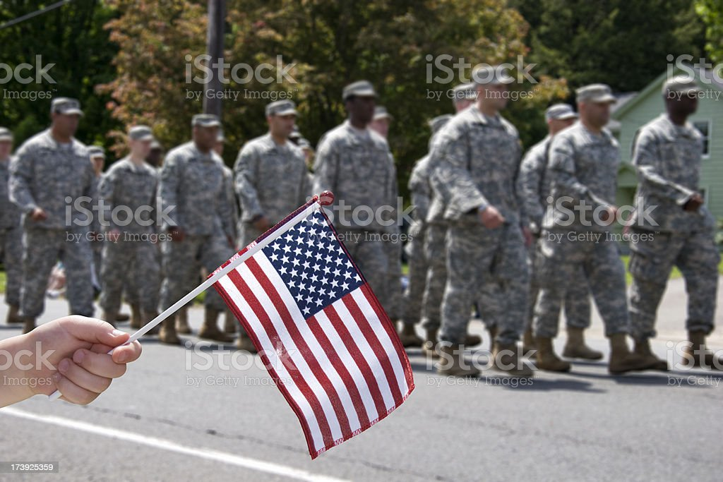 Waving the Flag for soldiers stock photo