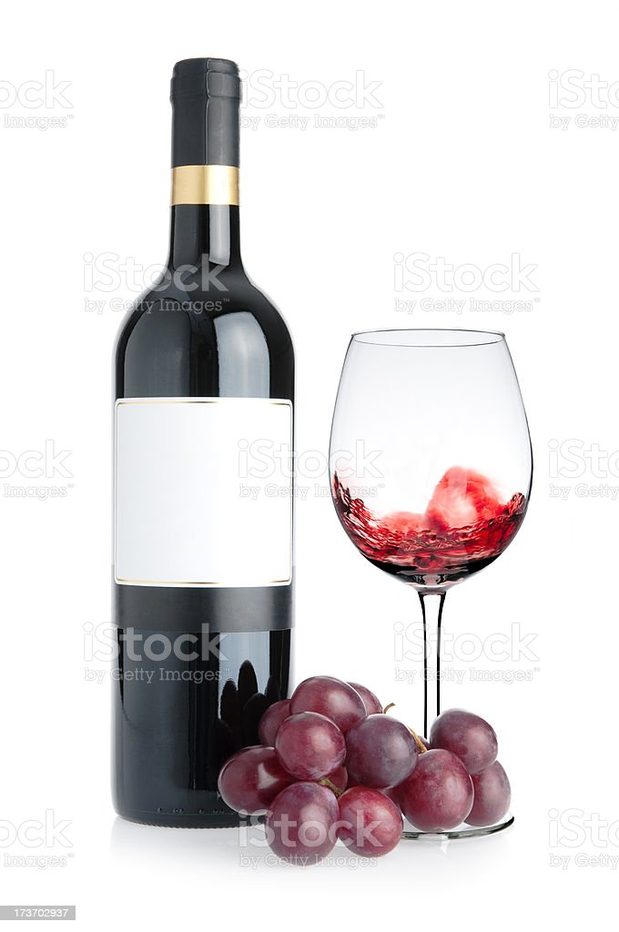 Waving Wine Bottle and Grapes stock photo