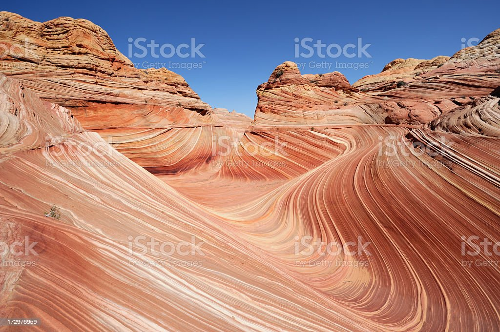Wavy desert sands, dunes, and cliffs stock photo