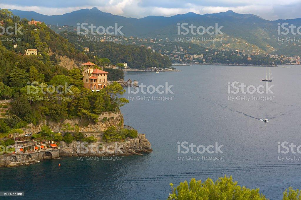 Wavy road along Portofino cove, street cut into cliff, Portofino stock photo
