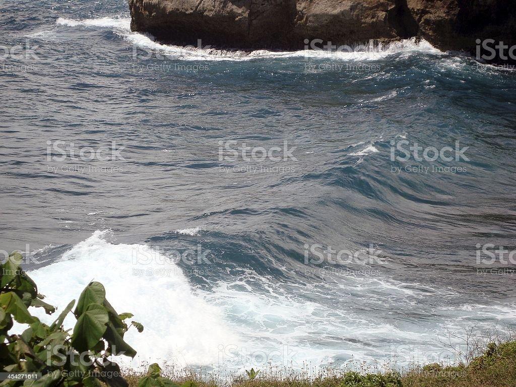 Wavy rocky coastline, Nusa Lembongan, Indonesia royalty-free stock photo