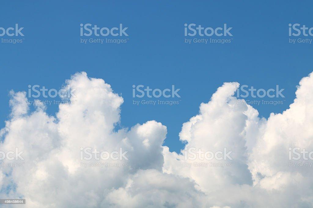 Wavy white cloud on blue sky stock photo