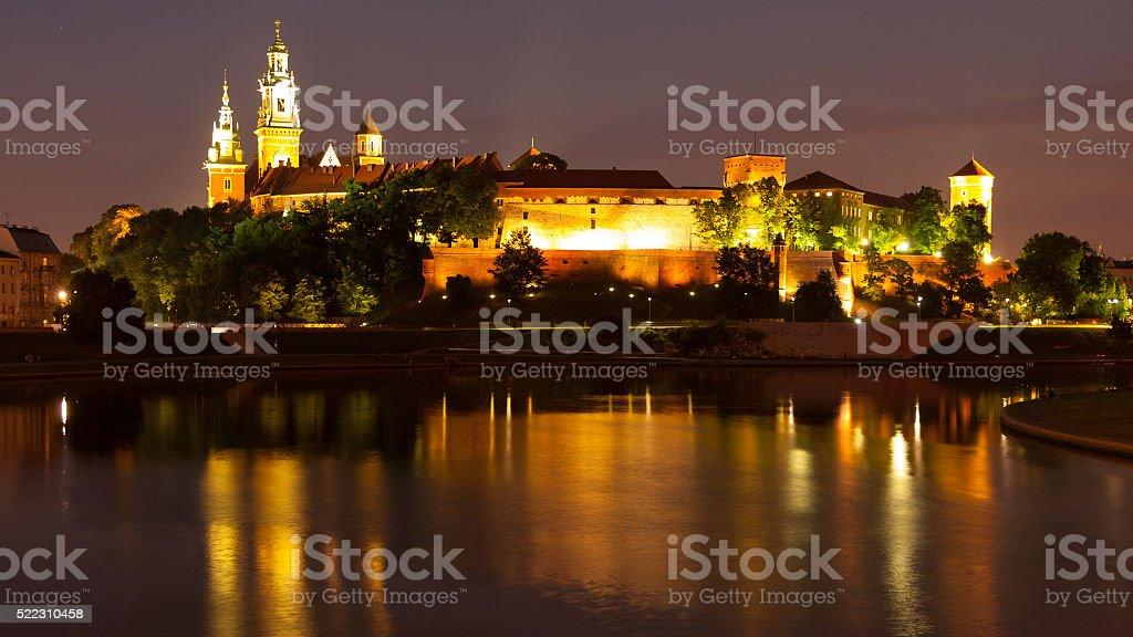 Wawel Hill above Vistula River in Krakow at night stock photo