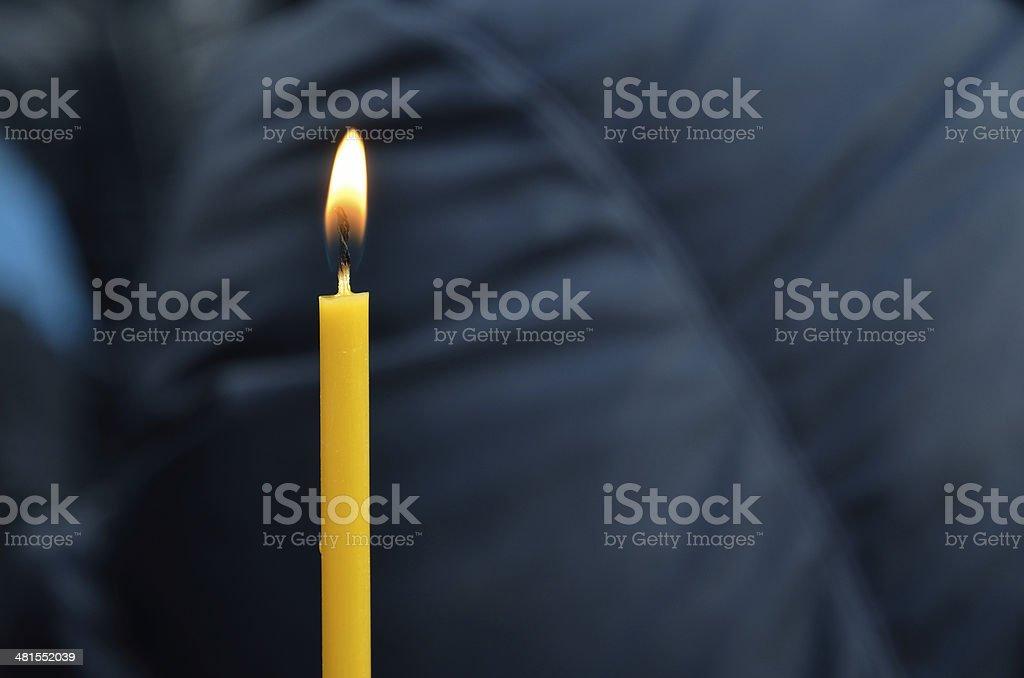 Wax candle burning outdoors. Ukrainian hope stock photo