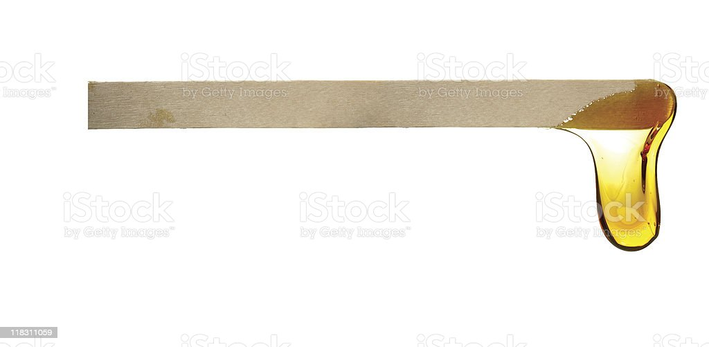 wax drop off wooden spatula stock photo