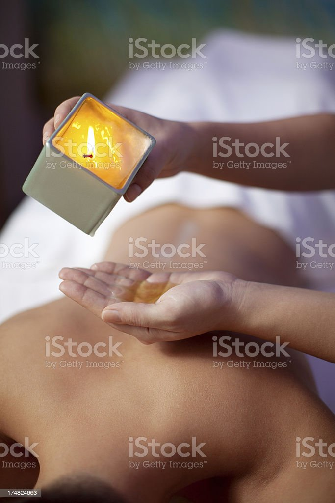Wax massage in the spa and wellness center stock photo