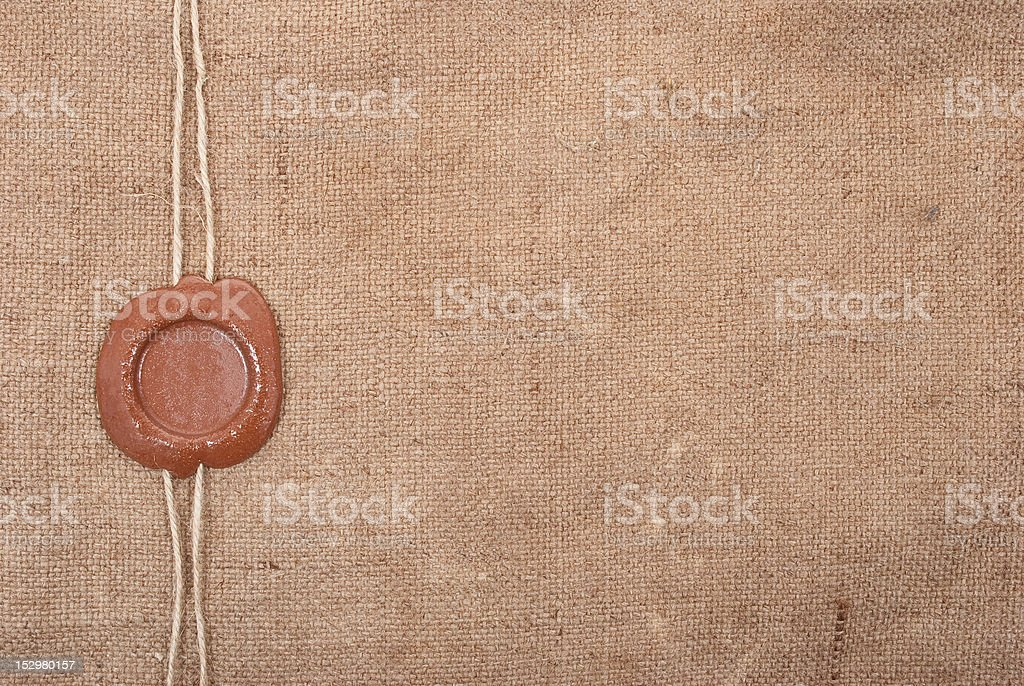Wax seal on sackcloth material royalty-free stock photo