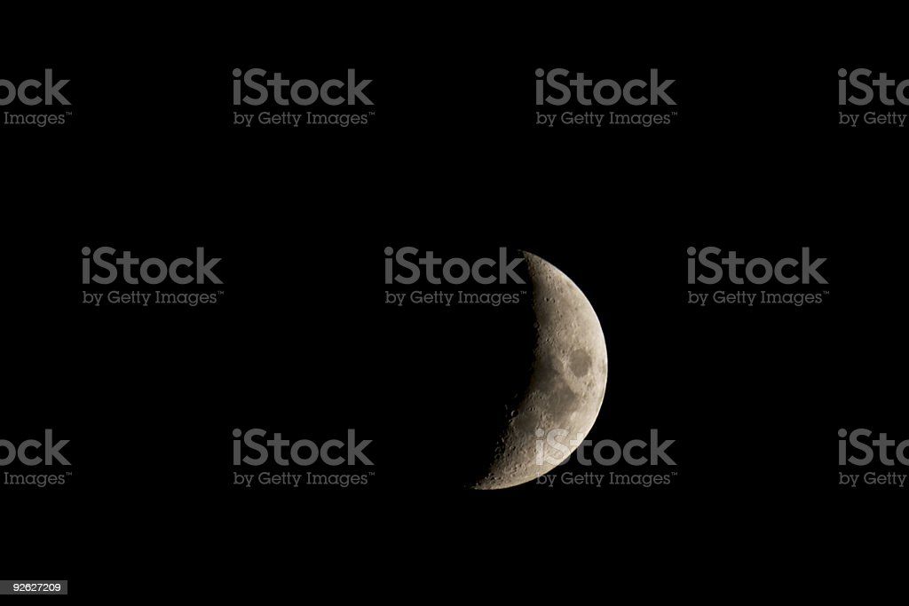Waxing crescent moon closeup isolated against a black night sky royalty-free stock photo