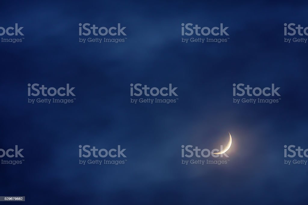 waxing crescent moon on sky stock photo