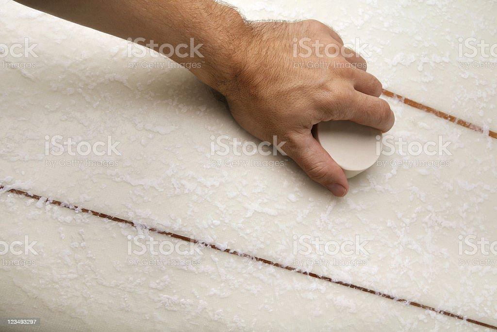 Waxing Surfboard stock photo