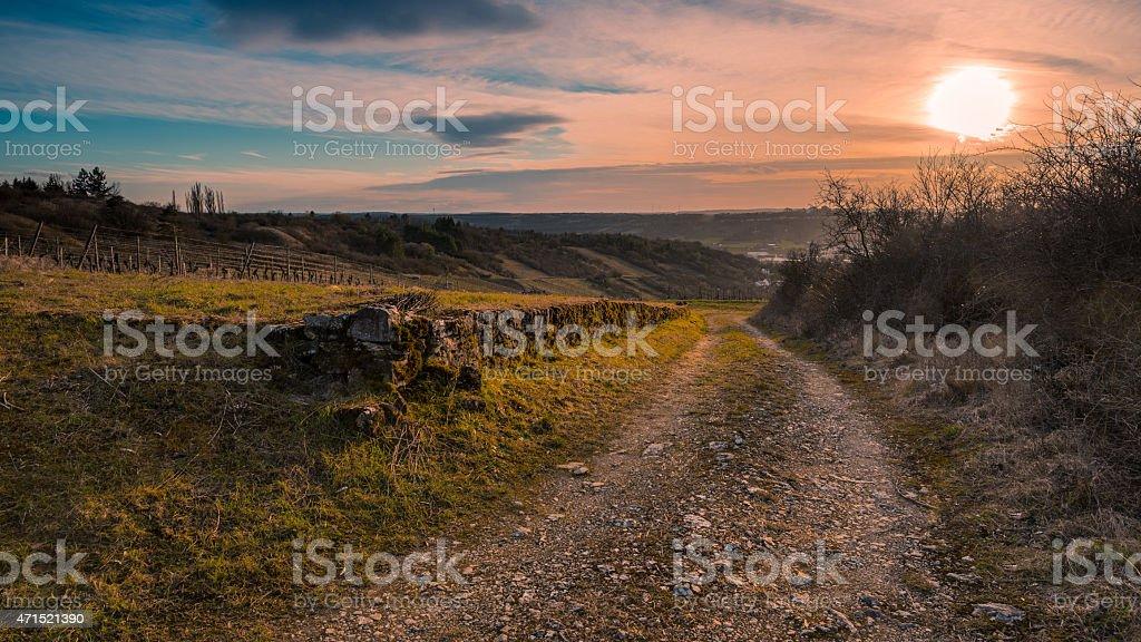 Route vers le coucher du soleil photo libre de droits