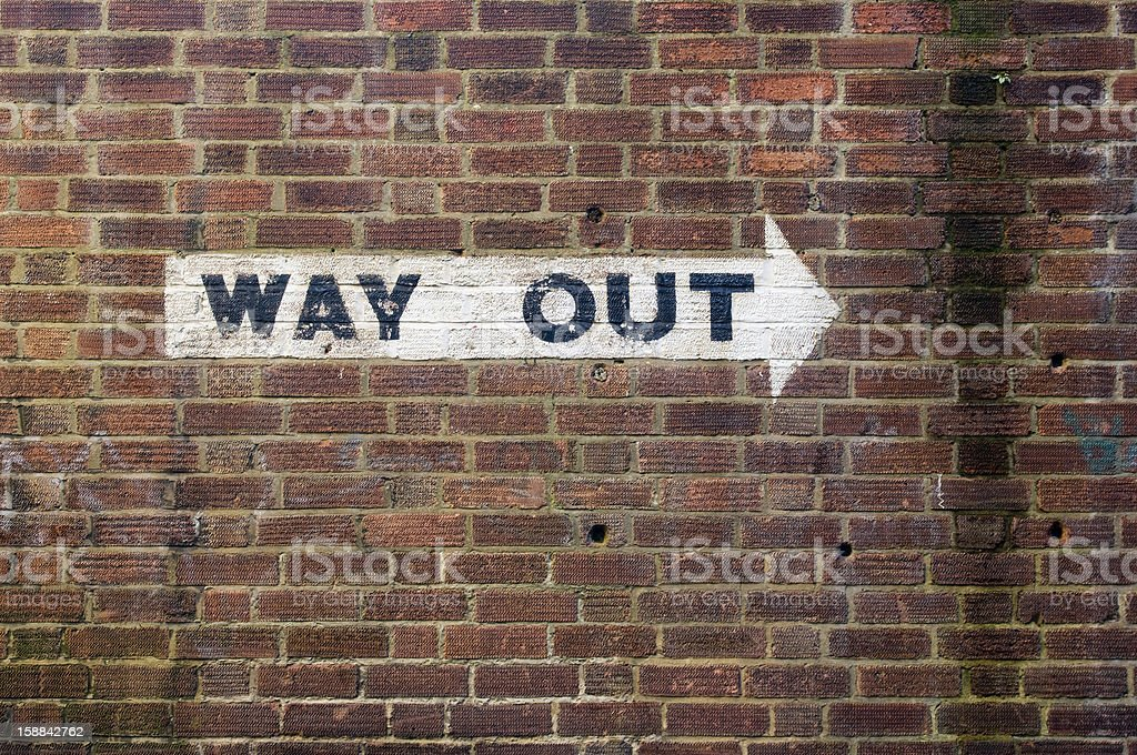 Way Out - Sign painted on dirty grungy wall royalty-free stock photo