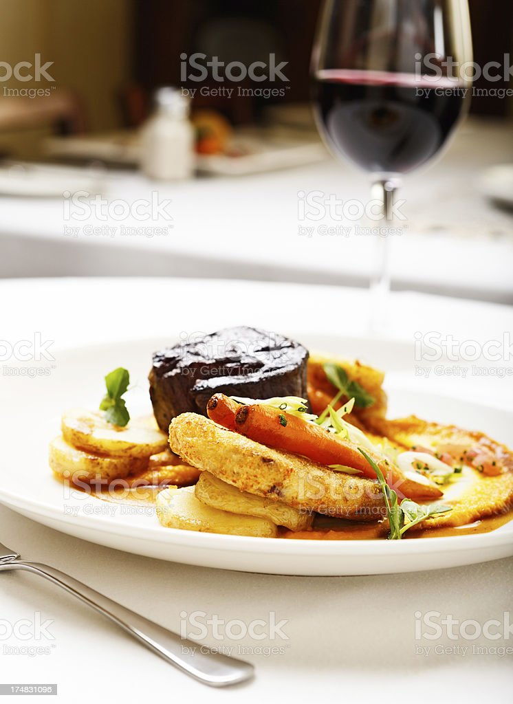 Way to a man's heart: steak, potatoes and red wine: royalty-free stock photo