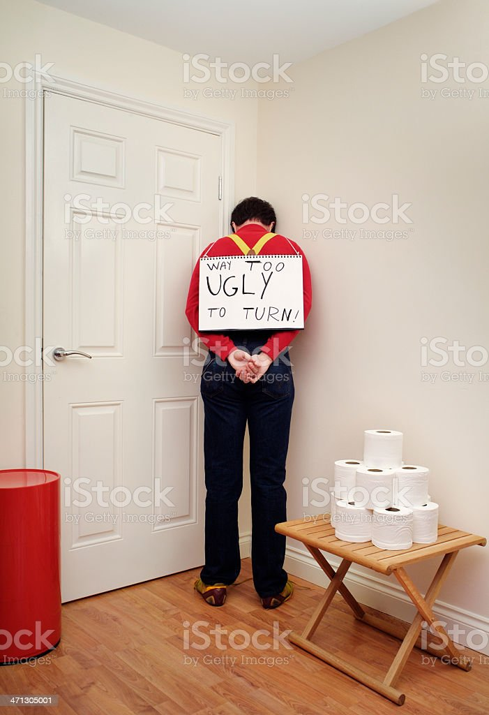 Way too ugly - Shy man ashamed of his look royalty-free stock photo