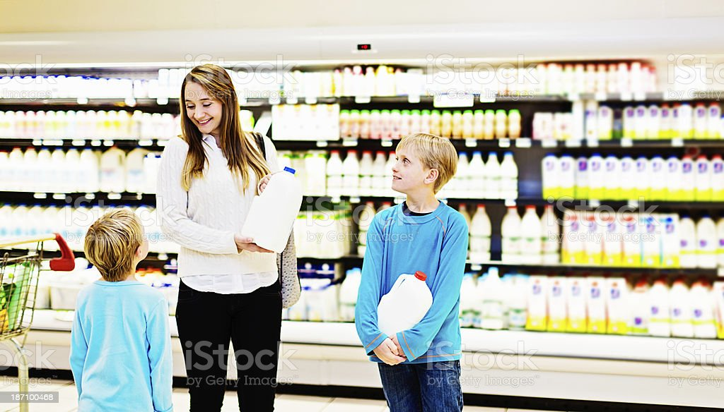 We all love milk! family buying dairy products in supermarket royalty-free stock photo