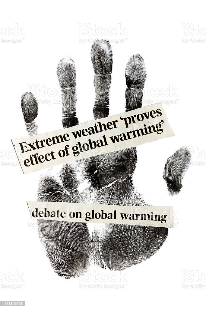 We are destroying the climate. Newspaper headlines on human handprint. royalty-free stock photo