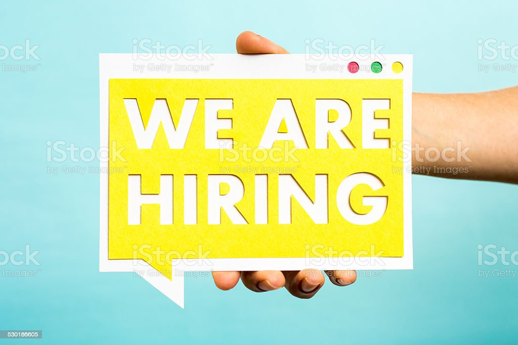 'We are hiring' job vacant speech bubble concept blue background stock photo