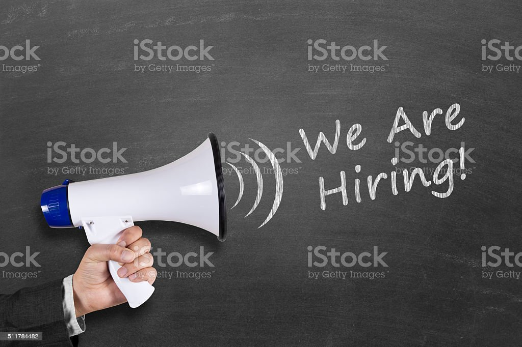 We are hiring text written on blackboard with megaphone stock photo
