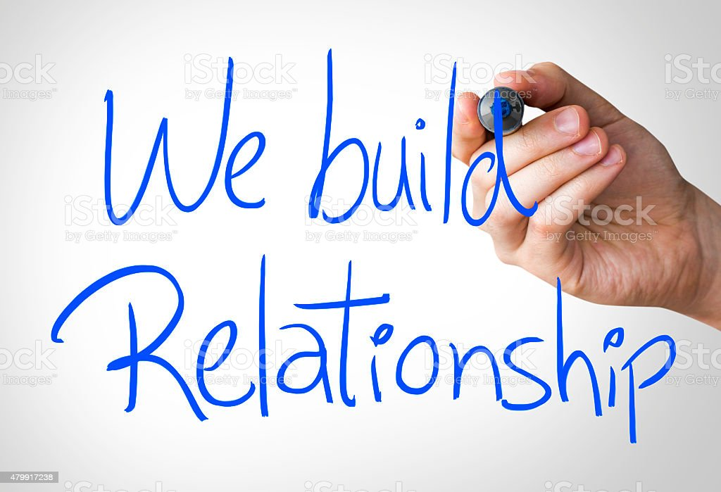 We Build Relationship written on the Wipe board stock photo
