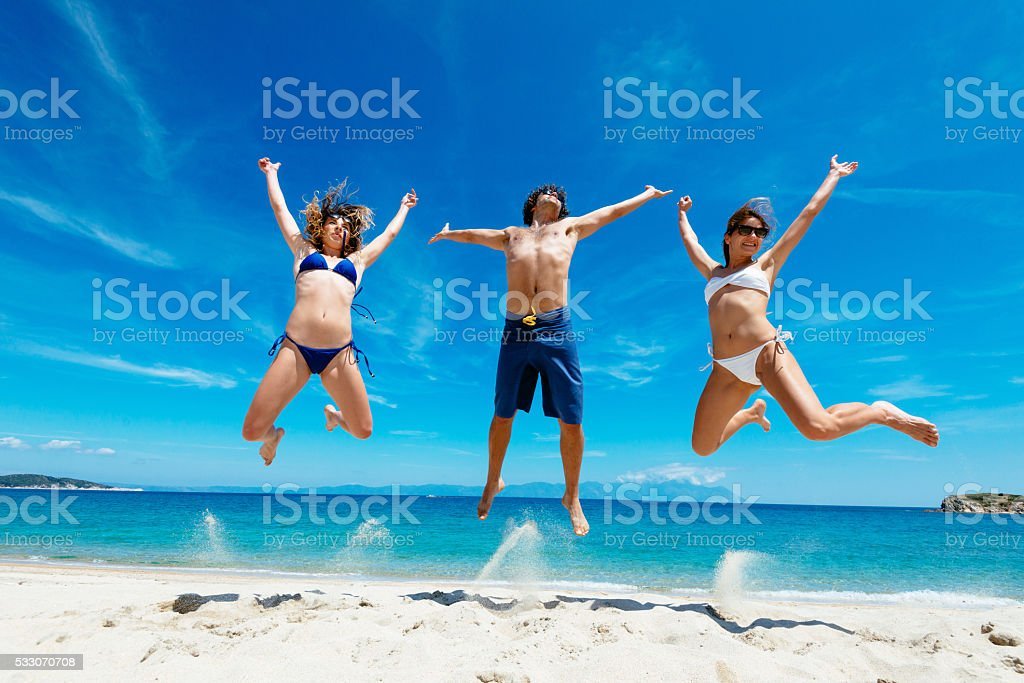 We enjoy our summer holiday on beach stock photo