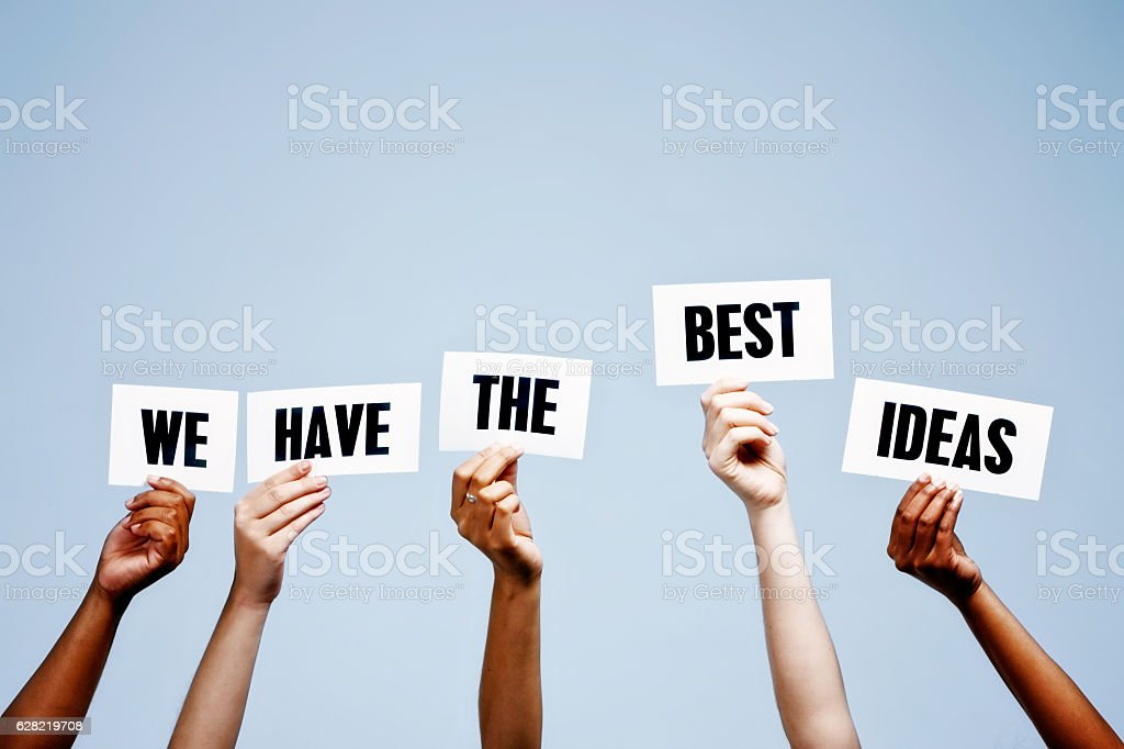 'We have the best Ideas' say hand-held words against blue stock photo