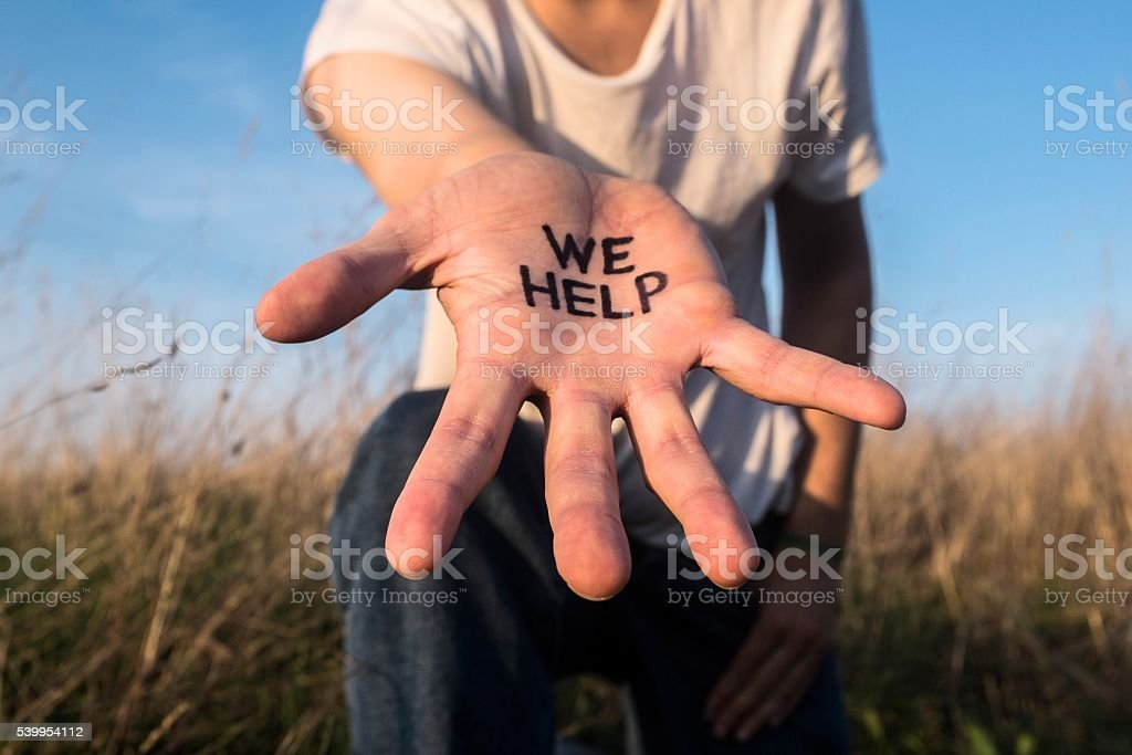 We help - helping hand stock photo