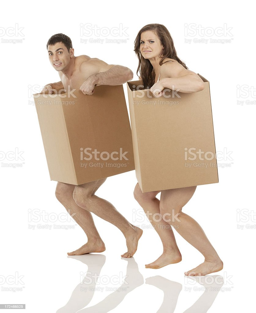 We lost everything! Naked couple in cardboard boxes royalty-free stock photo