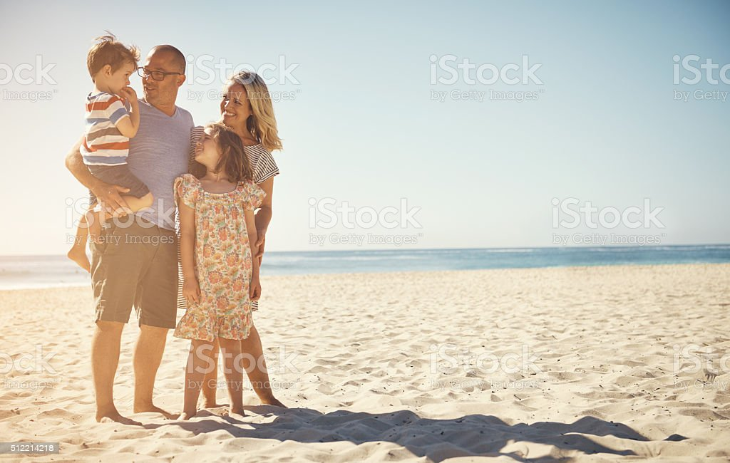 We love spending time at the beach stock photo