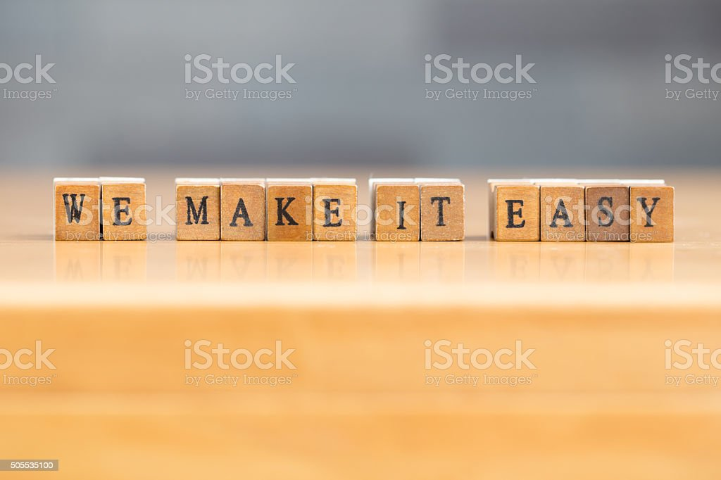We make it easy. word written on wood block stock photo