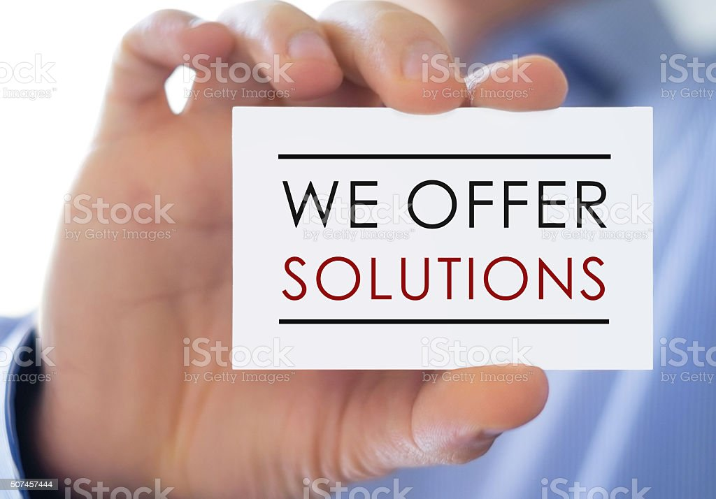 We offer solutions - business card stock photo