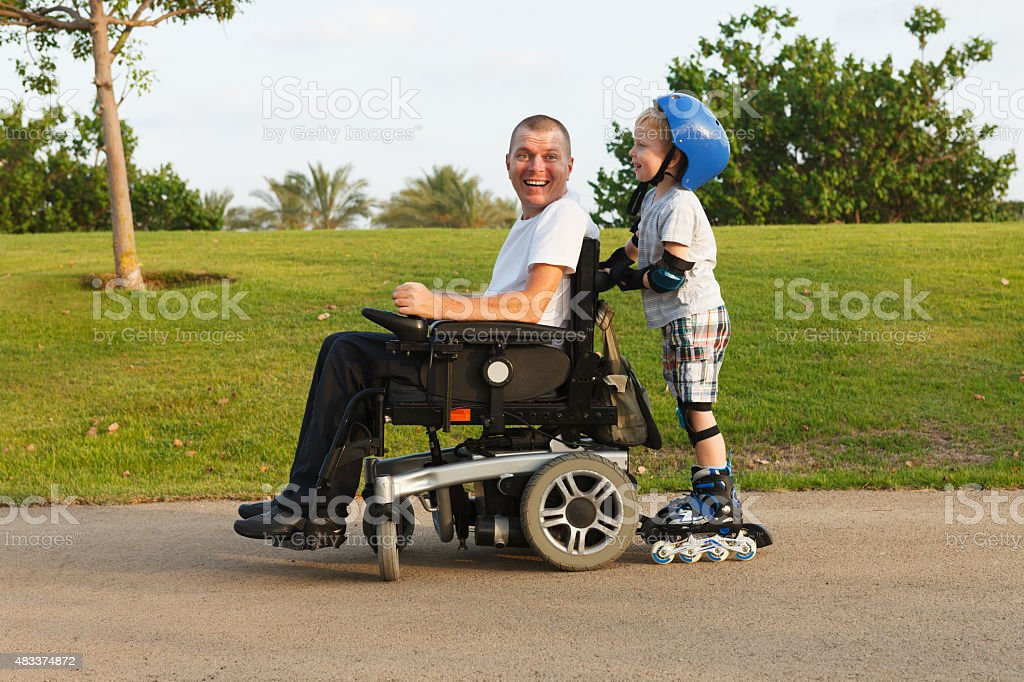 We rollerblading with son stock photo