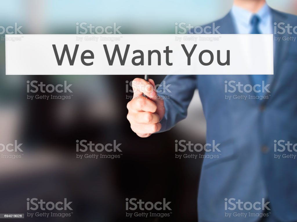 We Want You - Businessman hand holding sign stock photo