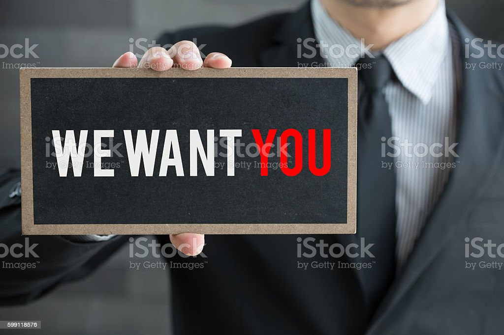 We want you, message on blackboard and hold by businessman stock photo