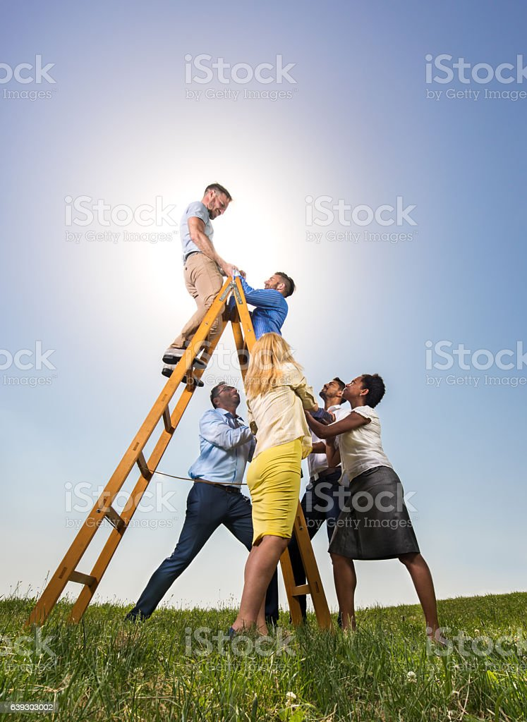 We will climb you to the top of the ladders! stock photo