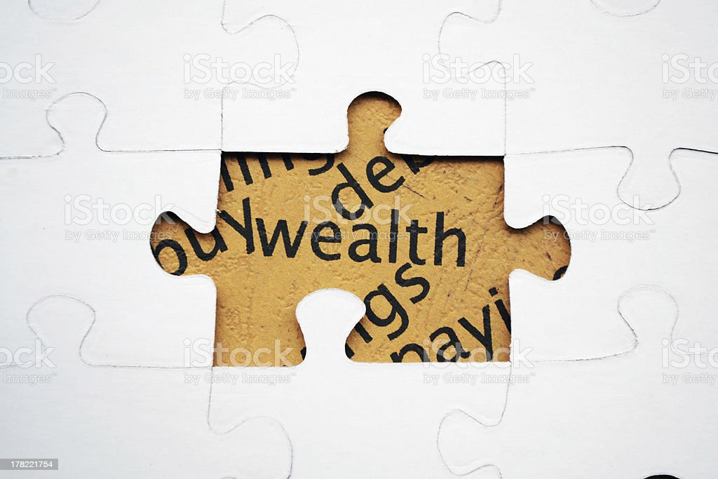Wealth puzzle concept royalty-free stock photo