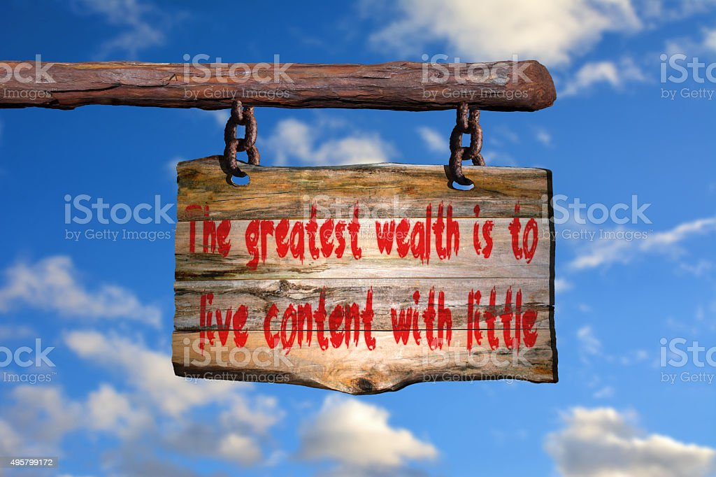 Wealth quote on old wood stock photo