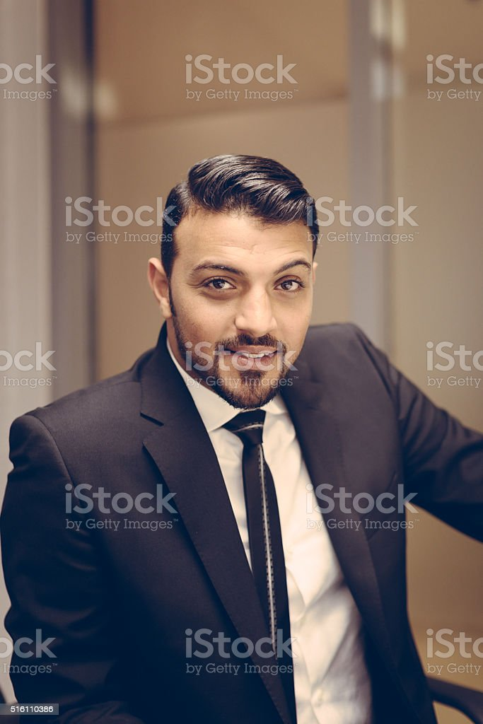 Wealthy businessman smiling after eventful meeting stock photo