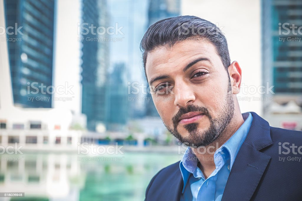 Wealthy businessman smiling towards the camera stock photo